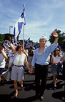 Montreal (Qc) CANADA - File Photo - circa 1992-<br /> <br /> Gilles Duceppe, deputy , the Bloc Quebecois and his wife (L),<br /> take part in the Saint-Jean Baptiste parade, June 24<br /> photo (c)  Images Distribution