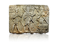 Hittite monumental relief sculpted orthostat stone panel from the Herald's Wall. Basalt, Karkamıs, (Kargamıs), Carchemish (Karkemish), 900-700 B.C. Military parade. Anatolian Civilisations Museum, Ankara, Turkey. Two helmeted soldiers in short skirts carry the shield on their backs and the spears in their hands.  <br /> <br /> Against a white background.