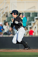 Mitch Roman (10) of the Kannapolis Intimidators follows through on his swing against the Asheville Tourists at Kannapolis Intimidators Stadium on May 6, 2017 in Kannapolis, North Carolina.  The Intimidators walked-off the Tourists 7-6.  (Brian Westerholt/Four Seam Images)