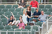 "Fans dance along with ""Y.M.C.A."" between innings of the South Atlantic League game between the Greensboro Grasshoppers and the Kannapolis Intimidators at Kannapolis Intimidators Stadium on August 13, 2017 in Kannapolis, North Carolina.  The Grasshoppers defeated the Intimidators 3-0.  (Brian Westerholt/Four Seam Images)"