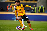 23rd May 2021; Molineux Stadium, Wolverhampton, West Midlands, England; English Premier League Football, Wolverhampton Wanderers versus Manchester United; Nélson Semedo of Wolverhampton Wanderers moves the ball on the wing looking for the next pass
