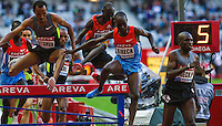 06 JUL 2012 - PARIS, FRA - Jairus Birech (second from right), Brimin Kipruto (third from right) and Birhan Getahun (left) follow Paul Koech of Kenya over a hurdle during the men's 3000m Steeplechase race at the 2012 Meeting Areva held in the Stade de France in Paris, France (PHOTO (C) 2012 NIGEL FARROW)