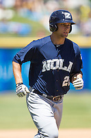 New Orleans Zephyrs outfielder Kyle Jensen #20 runs to first base during the Pacific Coast League baseball game against the Round Rock Express on May 4, 2014 at the Dell Diamond in Round Rock, Texas. The Express defeated the Zephyrs 15-12. (Andrew Woolley/Four Seam Images)