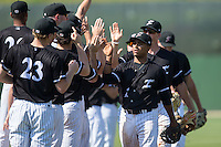 Dante Flores (1) of the Kannapolis Intimidators high fives teammates following their win over the Lakewood BlueClaws at Kannapolis Intimidators Stadium on May 8, 2016 in Kannapolis, North Carolina.  The Intimidators defeated the BlueClaws 3-2.  (Brian Westerholt/Four Seam Images)