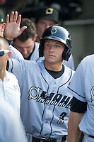Omaha Storm Chasers outfielder David Lough #3 is greeted in the dugout during the Pacific Coast League baseball game against the Round Rock Express on July 22, 2012 at the Dell Diamond in Round Rock, Texas. The Express defeated the Chasers 8-7 in 11 innings. (Andrew Woolley/Four Seam Images)..