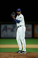 Tri-City Dust Devils relief pitcher Starlin Cordero (27) prepares to deliver a pitch during a Northwest League game against the Vancouver Canadians at Gesa Stadium on August 21, 2019 in Pasco, Washington. Vancouver defeated Tri-City 1-0. (Zachary Lucy/Four Seam Images)