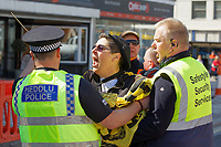 Pictured: An anti-lesbian protester is removed by police and security officers. Saturday 04 May 2019<br /> Re: Swansea Pride Parade in south Wales, UK.