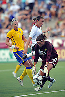 Sofia Lundgren gets to the ball before Abby Wambach...USWNT tied Sweden 1-1 at Morison Stadium, Nebraska.