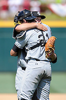 Starting pitcher Wil Crowe (37) of the South Carolina Gamecocks is hugged by catcher Grayson Greiner (21) after an NCAA Division I Baseball Regional Tournament game against the Campbell Camels on Sunday, June 1, 2014, at Carolina Stadium in Columbia, South Carolina. USC won 9-0, and Crow won the complete game. (Tom Priddy/Four Seam Images)