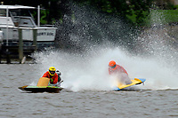 Frame 10: 300-P comes together with 911-Q, turns away and then is ejected from the boat.   (Outboard Hydroplanes)