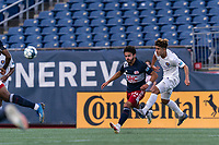 FOXBOROUGH, MA - AUGUST 7: Wilfredo Rivera #62 of Orlando City B heads the ball away from Ryan Spaulding #34 of New England Revolution II during a game between Orlando City B and New England Revolution II at Gillette Stadium on August 7, 2020 in Foxborough, Massachusetts.