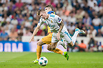 Toni Kroos of Real Madrid gets tripped as he battles for the ball with Roland Sallai of APOEL FC during the UEFA Champions League 2017-18 match between Real Madrid and APOEL FC at Estadio Santiago Bernabeu on 13 September 2017 in Madrid, Spain. Photo by Diego Gonzalez / Power Sport Images