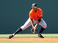 Shortstop Sharlon Schoop (2) of the Augusta GreenJackets picks up a grounder and throws for an out in a game against the Greenville Drive on May 23, 2010, at Fluor Field at the West End in Greenville, S.C. Photo by: Tom Priddy/Four Seam Images