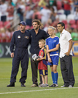Kyle Beckerman and Javier Morales pose after receiving game ball from USAF paratroopers. Real Salt Lake tied the Colorado Rockies, 1-1, at Rio Tinto Stadium on June 6, 2009.