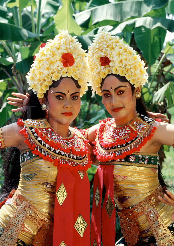 Portrait of two female Indonesian dancers in traditional costumes. Bali, Indonesia.