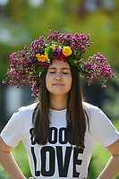BNPS.co.uk (01202 558833)<br /> Pic: ZacharyCulpin/BNPS<br /> <br /> Pictured: Yoga instructor, Larua Trosh enjoys the spring sunshine with her  flower crown created as part of Garden Day<br /> <br /> Londoners celebrate Garden Day by making flower crowns in the gardens of St George the Martyr church in Southwark.  <br /> <br /> Garden Day is back for a third successive year on Sunday, 9th May 2021 to celebrate outdoor and indoor garden spaces. The nationwide movement is called on plant-lovers to make a flower crown, and share their plant spaces with family and<br /> friends