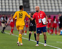 KASHIMA, JAPAN - AUGUST 2: Adrianna Franch #18 of the USWNT and Philip Poole high five during a game between Canada and USWNT at Kashima Soccer Stadium on August 2, 2021 in Kashima, Japan.