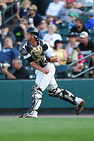 Rochester Red Wings catcher Dan Rohlfing (16) throws to first during the second game of a doubleheader against the Buffalo Bisons on July 6, 2014 at Frontier Field in Rochester, New  York.  Rochester defeated Buffalo 6-1.  (Mike Janes/Four Seam Images)