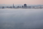 The summer fog underlines the San Francisco skyline as seen up in the Marin Headlands of Sausalito, California.