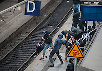 Anti fascists mobilise in Hamburg against a Nazi protest 12-9-15. Hamburg station is locked down by riot police as anti fascists attack nazis arriving for a banned far right protest. The police were deployed in very large numbers and nazis trying to arrive by train were confined to the station. There were few arrests. A train with nazis on board gets pelted with stones by anti fascists.