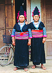 Dzoe women in traditional dressed in traditional clothes. From remote village in market place in Tuan Giao, Vietnam.