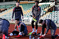 Pictured: Players wear the boots pitch side before the start of their training session. Thursday 18 January 2018<br /> Re: Players and staff of Newport County Football Club prepare at Newport Stadium, for their FA Cup game against Tottenham Hotspur in Wales, UK