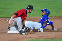 Deion Ulmer (3) of the Ogden Raptors avoids the tag by Grant Massey (10) of the Great Falls Voyagers at Lindquist Field on July 16, 2015 in Ogden, Utah. Ogden defeated Great Falls 5-2. (Stephen Smith/Four Seam Images)