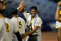 Bradenton Marauders pitcher Luis Ortiz (41) congratulates Norkis Marcos (3) after scoring a run during a game against the Dunedin Blue Jays on June 5, 2021 at TD Ballpark in Dunedin, Florida.  (Mike Janes/Four Seam Images)