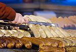 Germany, Mecklenburg-West Pomerania, Schwerin: Christmas fair, sausage grill | Deutschland, Mecklenburg-Vorpommern, Schwerin: Weihnachtsmarkt, Wuerstchenstand