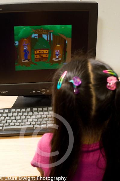 Preschool 3-4 year olds girl using computer in classroom