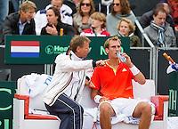 14-09-12, Netherlands, Amsterdam, Tennis, Daviscup Netherlands-Swiss,  Dutch bench with captain Jan Siemerink and Thiemo de Bakker, in the background Edwin van der Sar and Marco Bosato