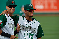 Fort Wayne TinCaps Justin Lopez (14) and Tucupita Marcano (15) before a Midwest League game against the Peoria Chiefs on July 17, 2019 at Parkview Field in Fort Wayne, Indiana.  Fort Wayne defeated Peoria 6-2.  (Mike Janes/Four Seam Images)