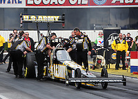 Feb. 12, 2012; Pomona, CA, USA; NHRA crew members for top fuel dragster driver Tony Schumacher during the Winternationals at Auto Club Raceway at Pomona. Mandatory Credit: Mark J. Rebilas-
