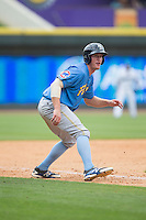 Jacob Rogers (27) of the Myrtle Beach Pelicans takes his lead off of third base against the Winston-Salem Dash at BB&T Ballpark on May 10, 2015 in Winston-Salem, North Carolina.  The Pelicans defeated the Dash 4-3.  (Brian Westerholt/Four Seam Images)