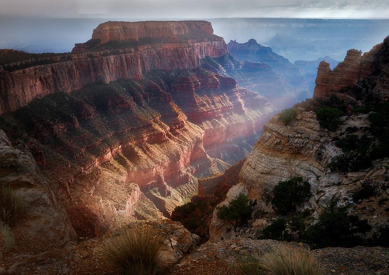 Light shining through thunderstromon on  Wotons Throne. Cape Royal. Grand Canyon National Park, Arizona