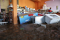 Pictured: A flooded shop caused by heavy rain in the area of Kinetta, near Athens, Greece. Monday 25 November<br /> Re: Heavy overnight rainfall has caused flooding and landslides in parts of Greece.