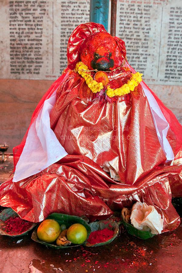 Kathmandu, Nepal.  Statue Representing the Hindu God Hanuman, the Monkey God, in a Neighborhood Temple.  Food Offerings in Front.