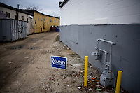 A Mitt Romney campaign sign stands in an alley in Manchester, New Hampshire, on Jan. 7, 2012.  Romney is seeking the 2012 Republican presidential nomination.