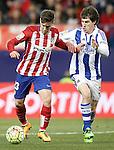 Atletico de Madrid's LucianoVietto (l) and Real Sociedad's Aritz Elustondo during La Liga match. March 1,2016. (ALTERPHOTOS/Acero)