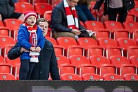 1st October 2021;  Bet365 Stadium, Stoke, Staffordshire, England; EFL Championship football, Stoke City versus West Bromwich Albion; A yound Stoke fan watches the game with his dad