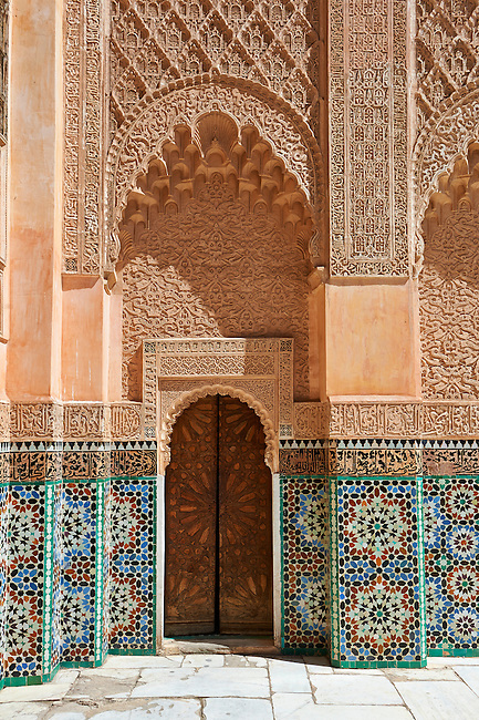 Berber arabesque Morcabe plasterwork and Zellige tiles of the 14th century Ben Youssef Madersa (Islamic college) re-constructed by the Saadian Sultan Abdallah al-Ghalib in 1564 as the largest and most prestigious Medersa in Morocco. Marrakesh, Morroco