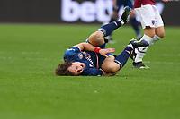 21st March 2021; London Stadium, London, England; English Premier League Football, West Ham United versus Arsenal; David Luiz of Arsenal goes down injured