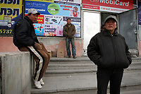 MONGOLIA. Ulaan Baatar. Battsetseg (right), 36, waits on the streets of Ulaan Baatar for her husband who went out looking for work earlier that morning. With no way of communicating with oneanother, she walks and waits, hoping to meet him. Life on the sreets is unpredictable however, so she spends many hours walking the streets alone, waiting.<br /> As the global financial crisis grips Asia, Mongolia is feeling the implications first hand as the country suffers from rising inflation pushing the price of food and fuel ever upwards. For the country's homeless, who live in sewers and abandoned garages in the capital and already face extreme discrimination and are denied access to basic health and social care, their lives are hanging in the balance. 2008