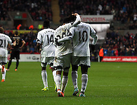 Wednesday, 01 January 2014<br /> Pictured: Wilfried Bony of Swansea (R) celebrating his equaliser with team mate Jonathan de Guzman, making the score 1-1.<br /> Re: Barclay's Premier League, Swansea City FC v Manchester City at the Liberty Stadium, south Wales.