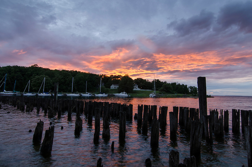 A fiery sunset over Snail Shell Harbor at Fayette Historic State Park.