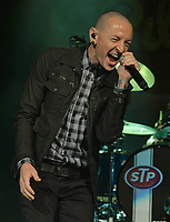 SUNRISE, FL - SEPTEMBER 17: Chester Bennington performs on stage with Stone Temple Pilots at BB&T Center on September 17, 2013 in Sunrise, Florida.  <br /> <br /> People:  Chester Bennington