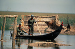 Marsh Arabs. Southern Iraq.  Marsh Arab soldiers in boats after destruction of village during / after Iran Iraq border dispute war. 1980s