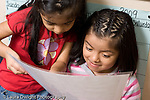 Education Preschool 3-5 year olds two girls looking at sign or illustration horizontal