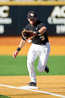 Third baseman Carlos Lopez #3 of the Wake Forest Demon Deacons fields a ground ball against the Miami Hurricanes at Gene Hooks Field on March 19, 2011 in Winston-Salem, North Carolina.  The Hurricanes defeated the Demon Deacons 4-3.  Photo by Brian Westerholt / Four Seam Images