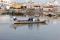 Senegal, Saint Louis.  Canoe Ferrying Passengers across the Senegal River, from Ile de N'Dar to Guet N'Dar Neighborhood on the Langue de Barbarie Peninsula.